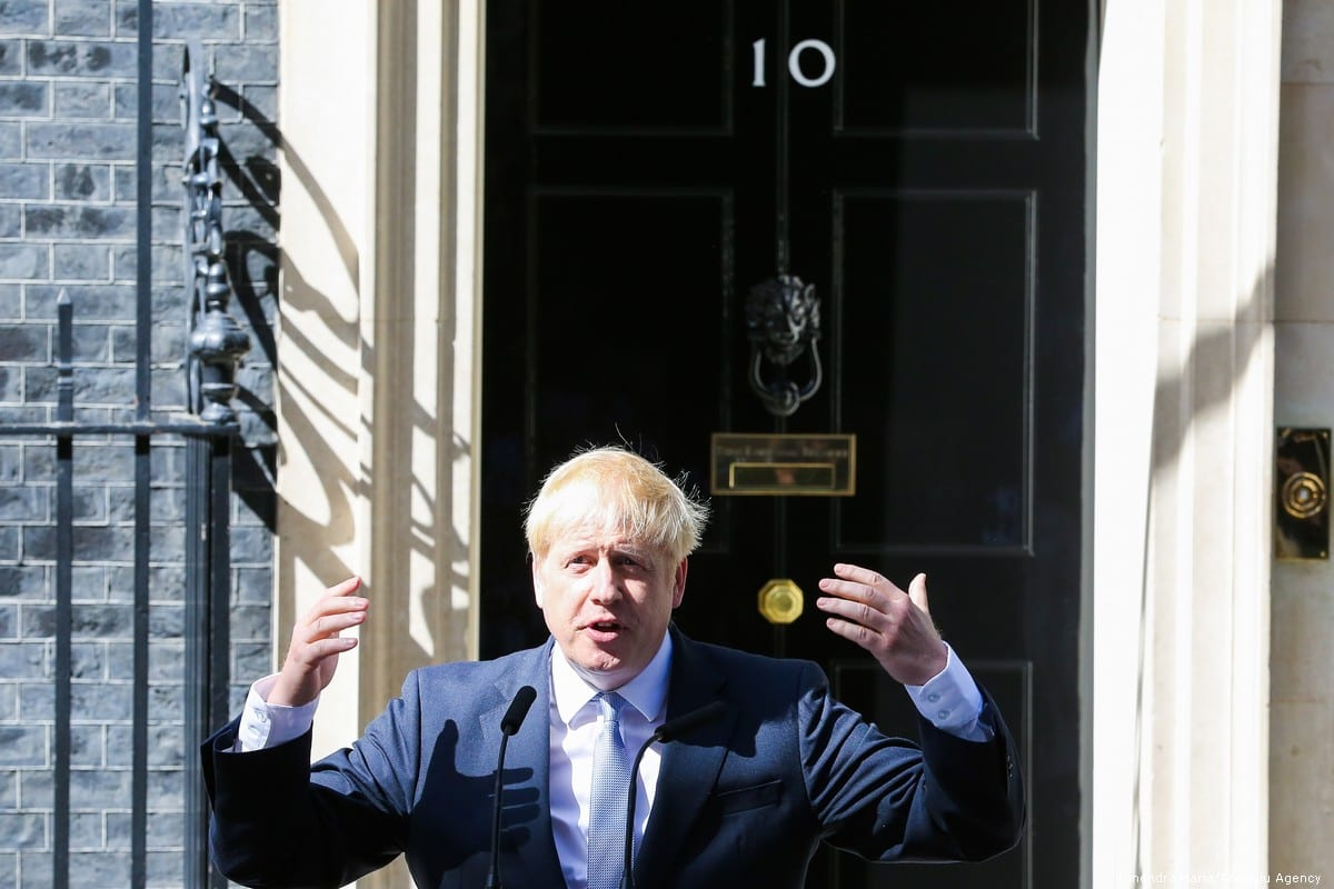 New British Prime Minister Boris Johnson waves to the media on the steps of No 10 Downing Street in London, UK on 24 July 2019 [Dinendra Haria/Anadolu Agency]