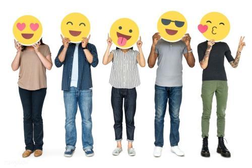 People holding Happy Emojis