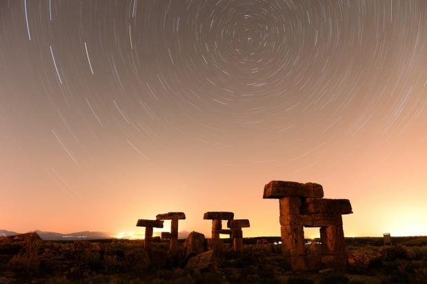 Starlight trails in the night sky over the ruins at Blaundus in Ulubey, Turkey on 3 July 2019 [Soner Kılınç/Anadolu Agency]