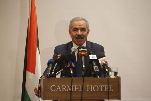 "Palestinian Prime Minister Mohammad Shtayyeh speaks during the opening of the annual meeting of Council of the Socialist International on ""The Two State Solution, Israel and Palestine, for Peace and a Future of Opportunities for the People of the Middle-East"" in Ramallah, West Bank on 30 July 2019. [Issam Rimawi - Anadolu Agency]"