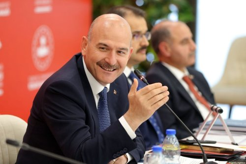 Minister of Interior of Turkey, Suleyman Soylu (L) gestures during a gathering with media representatives at Directorate General of Migration Management in Ankara, Turkey on 2 August 2019. [Barış ORAL - Anadolu Agency]