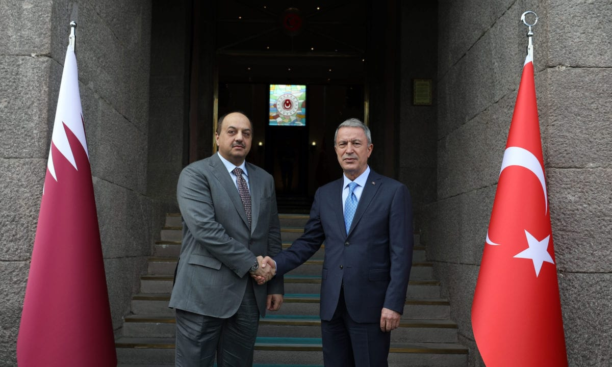 Turkish National Defense Minister Hulusi Akar (R) and Deputy Prime Minister and Minister of State for Defense of Qatar Khalid bin Mohammad Al Attiyah (L) shake hands as they pose during their meeting in Ankara, Turkey on 5 August 2019. [Arif Akdoğan - Anadolu Agency]