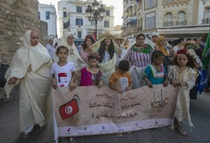 Tunisian women dressed traditional clothes, gather at Attarin market and march towards Avenue Habib Bourguiba to mark National Women's Day in Tunis, Tunisia on 13 August, 2019 [Yassine Gaidi/Anadolu Agency]