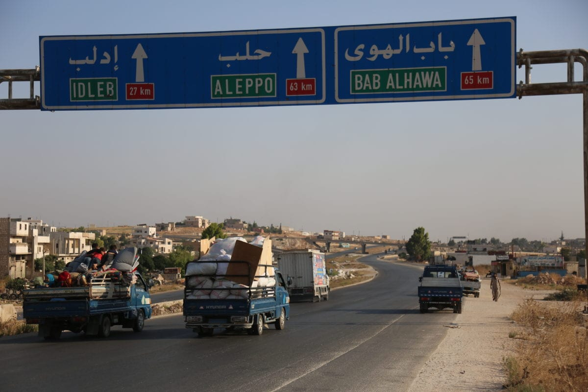 Vehicles carrying belongings of Syrian people who flee their lands as Russian backed Assad advances on de-escalation zone in Idlib, Syria on 16 August 2019. [İzeddin İdilbi - Anadolu Agency]