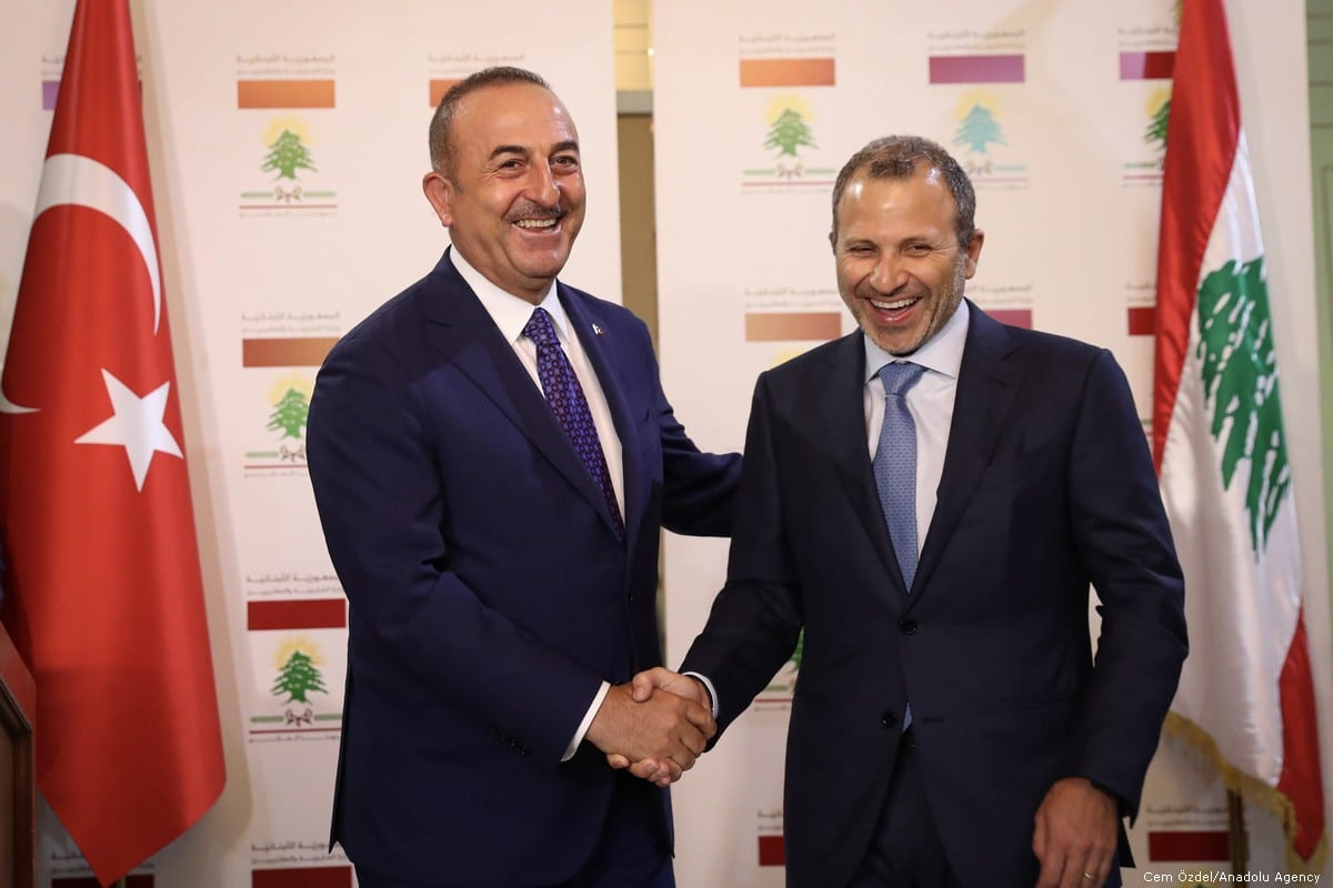 Minister of Foreign Affairs of Turkey, Mevlut Cavusoglu (L) and Minister of Foreign Affairs of Lebanon, Gebran Bassil (R) shake hands after giving a joint press conference in Beirut, Lebanon on 23 August, 2019 [Cem Özdel/Anadolu Agency]
