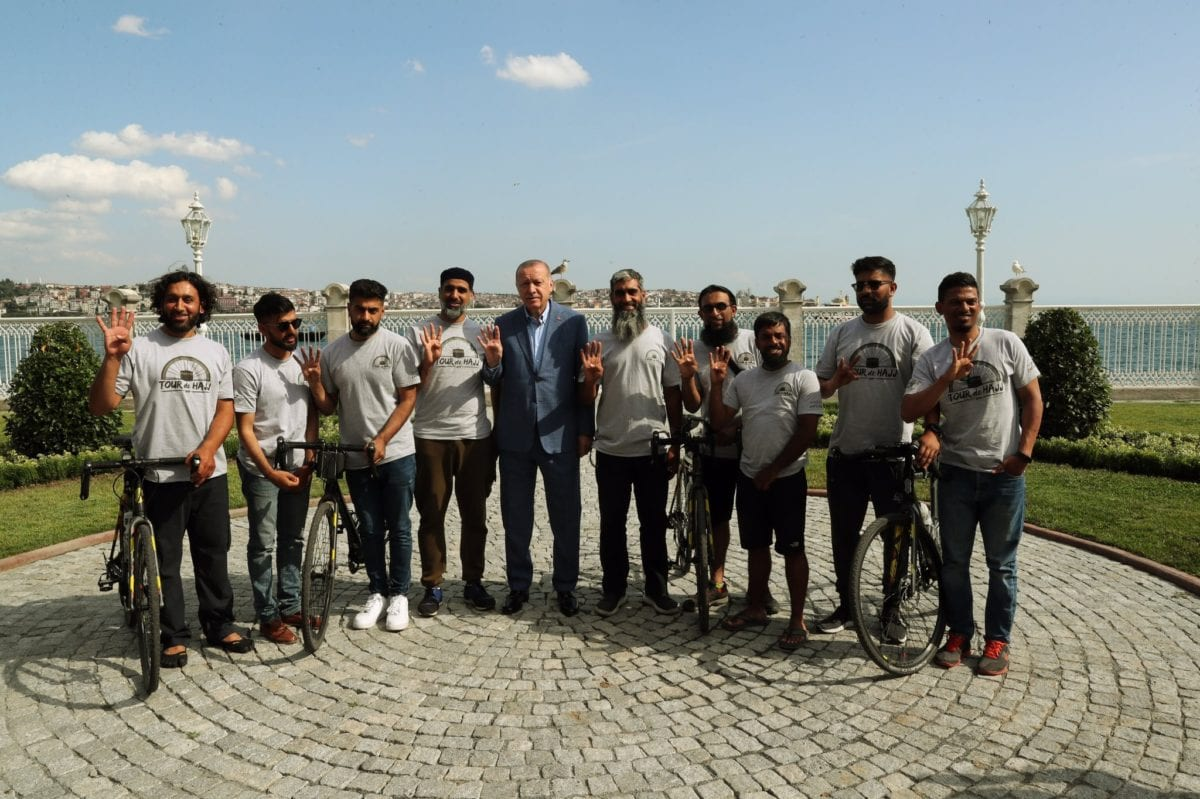 President Recep Tayyip Erdoğan receives 8 riders, cycling from London to Mecca for hajj, at Dolmabahçe Palace in Istanbul on 13 July 2019 [Anadolu Agency]