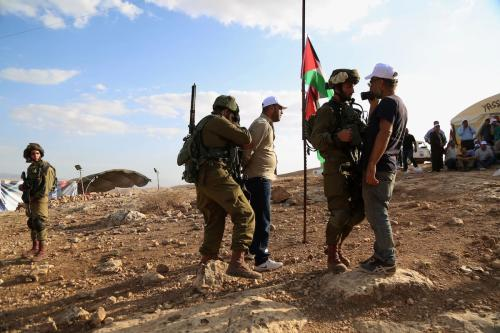Israelis soldiers arrested a Palestinian activist during a demonstration against the construction of Jewish settlements in the Jordan Valley near the West Bank city of Tubas, on 17 Nov. 2016. [Shadi Hatem-Apaimages]