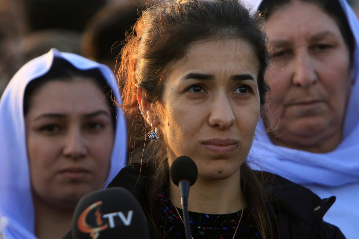 Nobel Peace Prize laureate, Yazidi activist Nadia Murad talks to people during her visit to Sinjar, Iraq on 14 December 2018. [REUTERS/Ari Jalal]