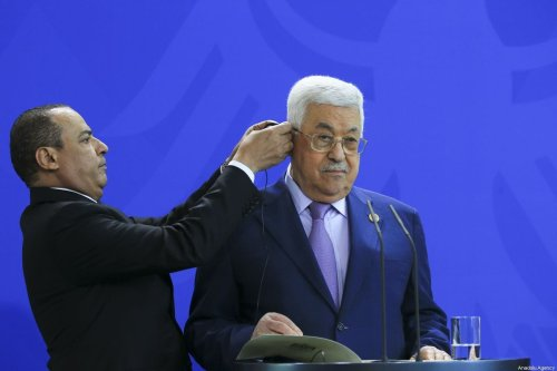 Palestinian President Mahmoud Abbas (R) receives an earphone during a joint news conference with German Chancellor Angela Merkel (not seen) before talks at the Chancellery in Berlin, Germany on August 29, 2019 [Abdülhamid Hoşbaş / Anadolu Agency]