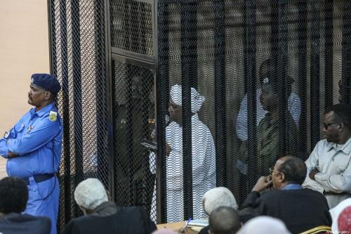 Sudan's ousted President Omar al-Bashir sits in a defendant's cage during his trial of illegal acquisition and use of foreign funds in Khartoum, Sudan on 31 August 2019. [Mahmoud Hjaj - Anadolu Agency]