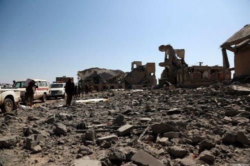People inspect a destroyed prison in Yemen on 1 September 2019 [Mohammed Hamoud/Anadolu Agency]