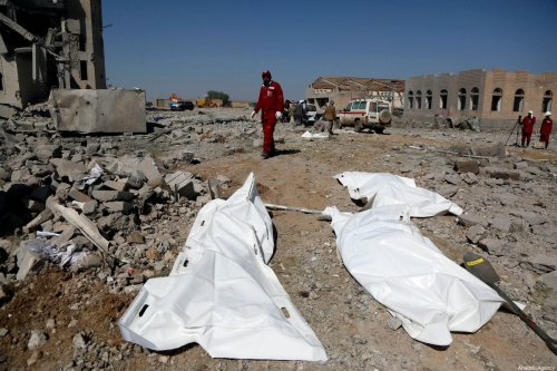 Yemen Red Crescent members conduct an operation after coalition forces led by Saudi Arabia organized an airstrike over a prison, in which Houthi Ansarullah movement members withhold its prisoners, in Dhamar, Yemen on 1 September 2019. [Mohammed Hamoud - Anadolu Agency]