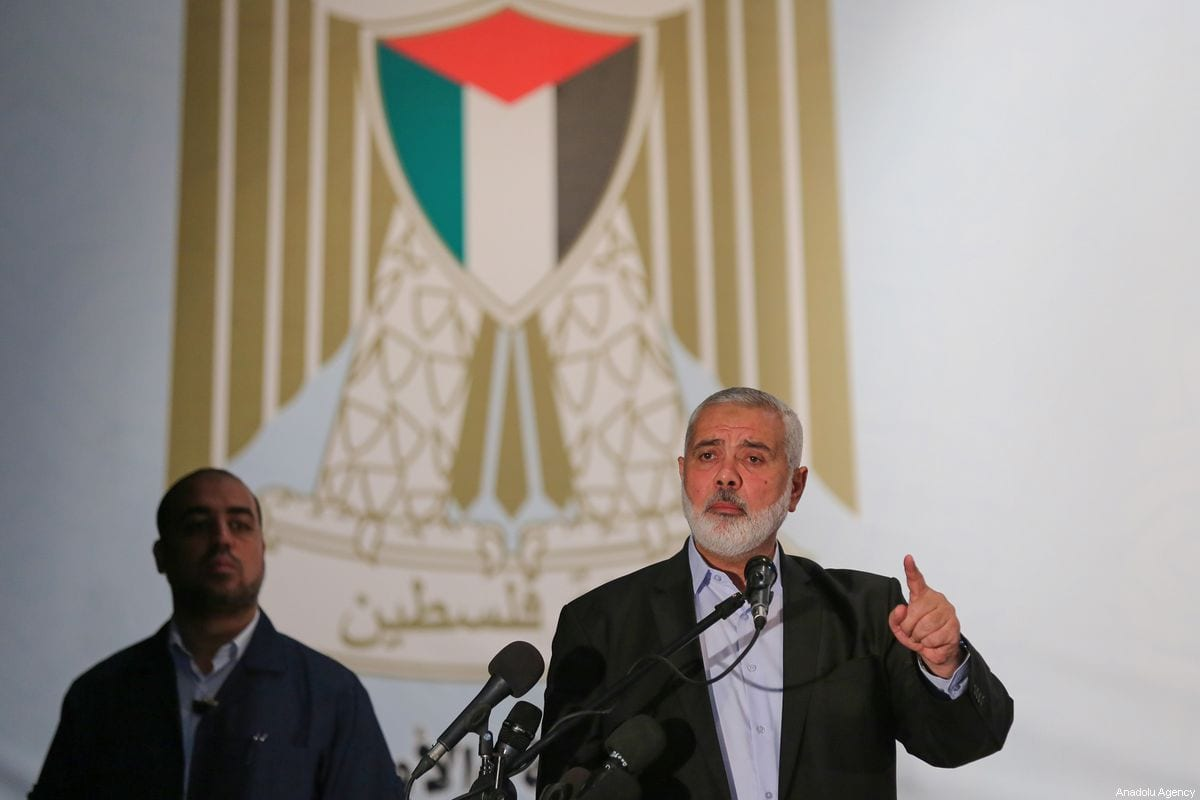 Head of the Political Bureau of Hamas Ismail Haniyeh delivers a speech during the commemoration ceremony for the three policemen in two suicide bomb attacks and in Gaza City, Gaza on 2 September 2019. [Mustafa Hassona - Anadolu Agency]