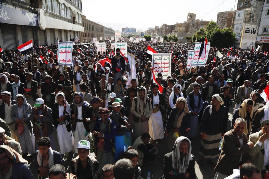Supporters of Houthis participate in march on the occasion of the fifth anniversary of Houthis' control of the Yemeni capital Sanaa, on 21 September 2019 [Mohammed Hamoud/Anadolu Agency]