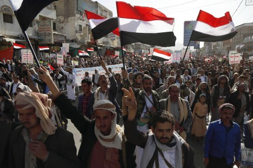 Supporters of Houthis participate in march on the occasion of the fifth anniversary of Houthis' control of the Yemeni capital Sanaa, on September 21, 2019 [Mohammed Hamoud / Anadolu Agency]