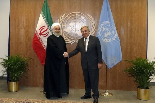 Iranian President Hassan Rouhani shakes hands with UN Secretary-General Antonio Guterres during the United Nations General Assembly at the United Nations on 25 September 2019 in New York City. [IRANIAN PRESIDENCY / HANDOUT - Anadolu Agency]