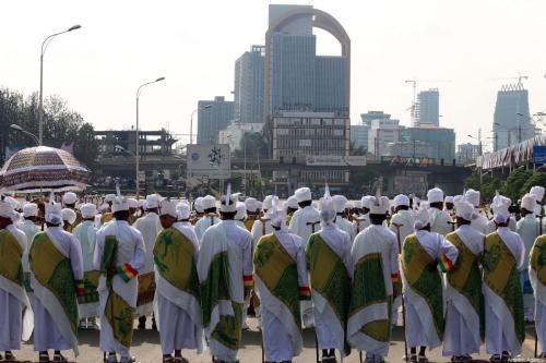 Priests attend the Meskel festival at Meskel Square in Addis Ababa, Ethiopia on 27 September 2019. [Minasse Wondimu Hailu - Anadolu Agency]