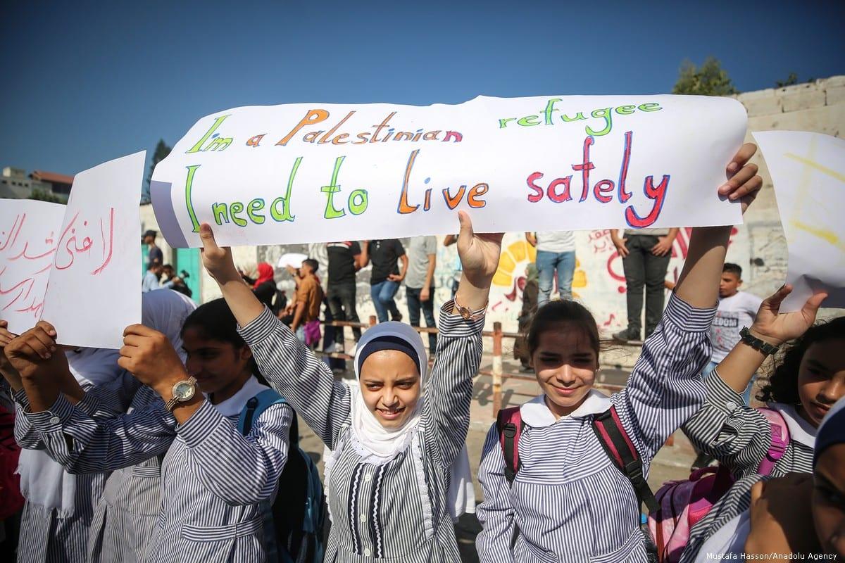 Palestinians gather at the UNRWA building on 17 September 2019 in Gaza City, Gaza [Mustafa Hassona/Anadolu Agency]