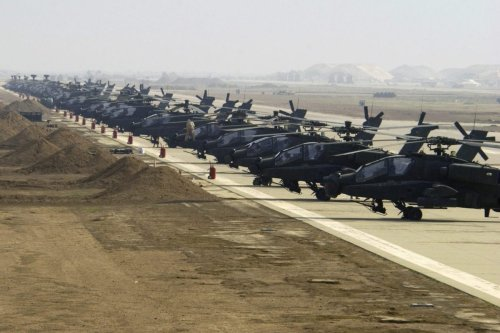 US Army Apache Longbow helicopters line the ramp at the airfield in Ein Al-Assad military base, Iraq, as seen on 7 January 2004 [SSGT Suzanne Jenkins, USAF]