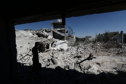 Damaged buildings in a residential area after the Assad Regime carried out air strikes in Idlib, Syria on 28 August 2019 [Muhammed Said/Anadolu Agency]