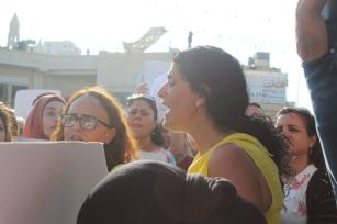 Lucy Talgieh, a member of the women's department in the Palestinian Center for Conflict Resolution, leading chants in Beit Sahour's main square