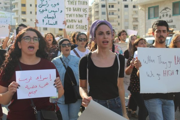 Manar Raje (right), 19, led Saturday's protest, calling for an end to all forms of violence, especially gender-based violence