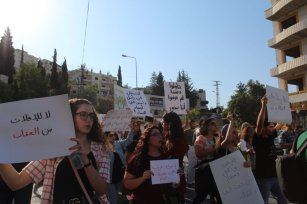 Rima Nael (left), 19, came to Bethlehem from Hebron to participate in Saturday's march and protest