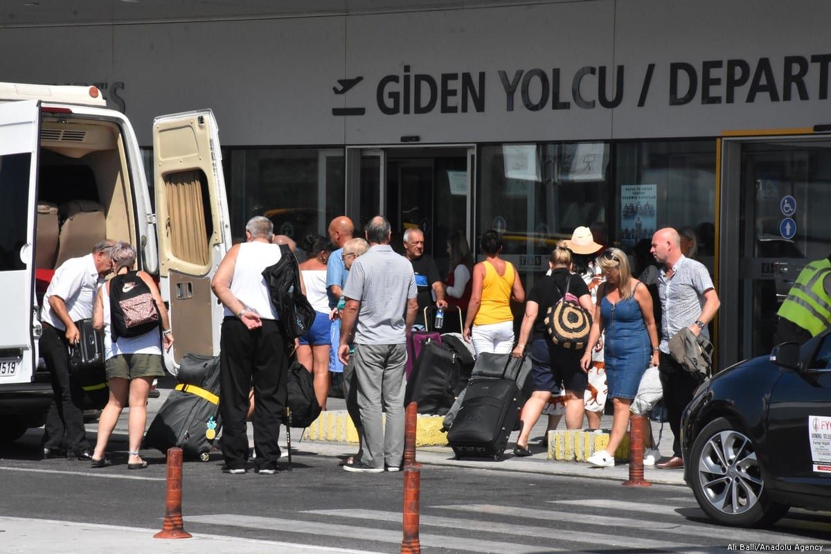 British tourists, flying with Thomas Cook, queue at Mugla Milas Airport, in Mugla, Turkey on 24 September 2019 [Ali Ballı/Anadolu Agency]