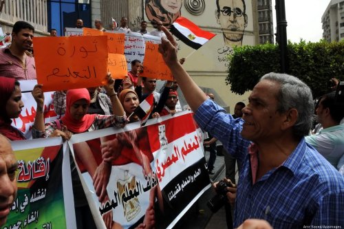Egyptian teachers and students shout slogans during a protest against the Minister of Education in Cairo on 10 September 2015 [Amr Sayed/Apaimages]