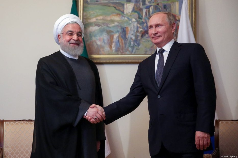Iranian President Hassan Rouhani (L) shakes hands with Russian President Vladimir Putin in Yerevan, Iran on 1 October 2019 [Iranian Presidency/Anadolu Agency]