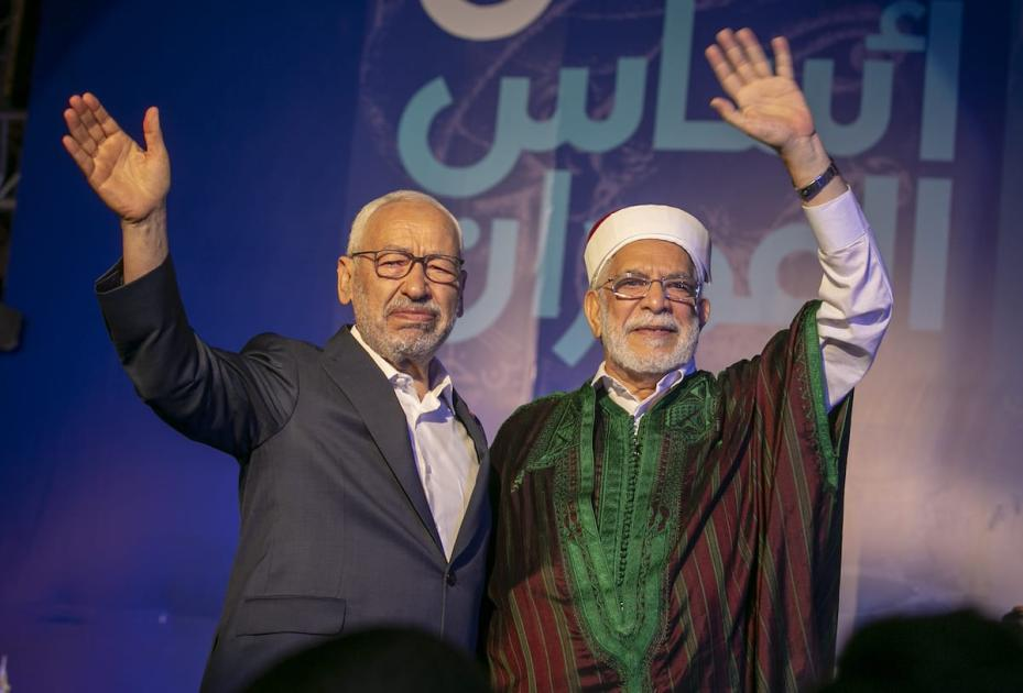Leader of Nahda Movement Rachid al-Ghannouchi (L) and Tunisian Deputy Parliament Speaker and Nahda Movement Candidate for the presidential election Abdulfettah Moro (R) greet people during a gathering within Nahda Movement's election campaign at Habib Burgiba Street ahead of Tunisia's presidential election in Tunis, Tunisia on 4 October 2019. [Yassine Gaidi - Anadolu Agency]