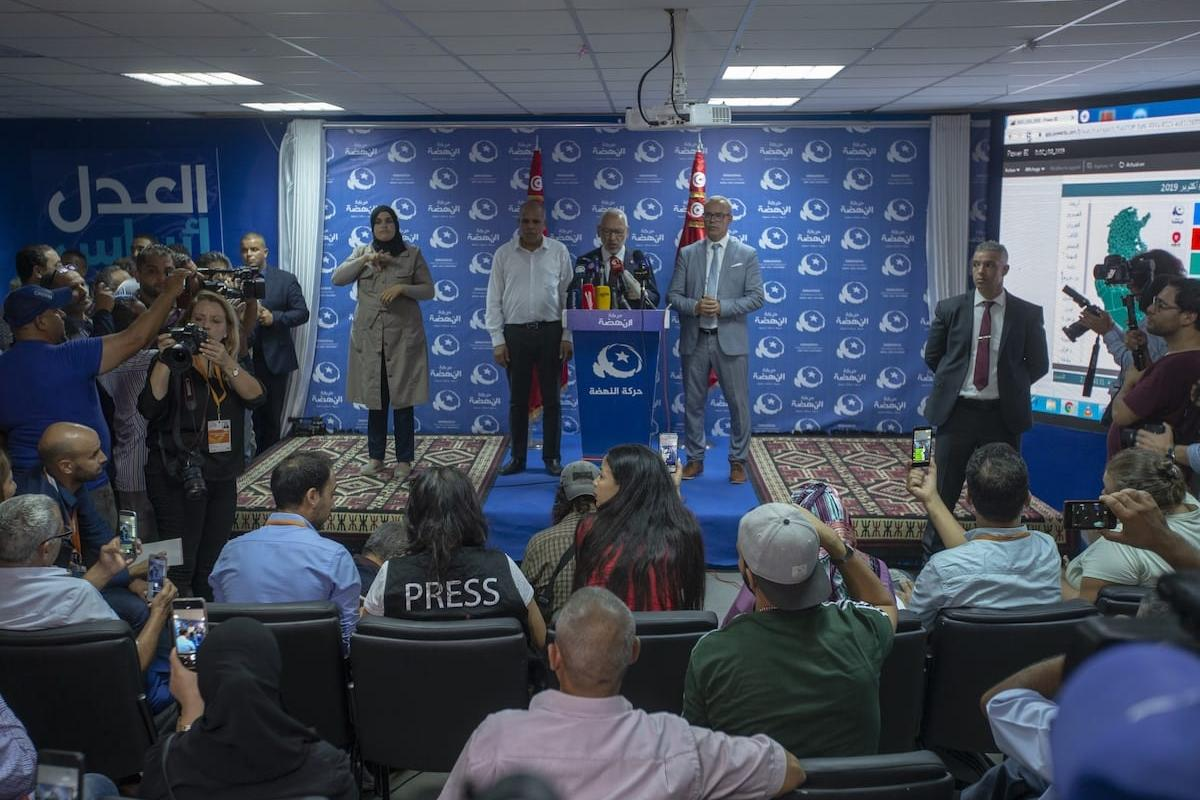 Leader of Nahda Movement Rachid al-Ghannouchi holds a press conference at his party's headquarters after the first announcement of early election results following the parliamentary elections in Tunis, Tunisia on 6 October 2019. [Yassine Gaidi - Anadolu Agency]