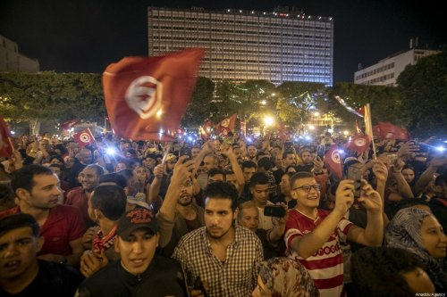 Tunisians gather to celebrate the victory of Tunisia's independent candidate Kais Saied after he has secured more than 72% of votes in the presidential election held on Sunday, said an exit polls agency, at Habib Burgiba Street in Tunis, Tunisia on 13 October 2019. [Yassine Gaidi - Anadolu Agency]