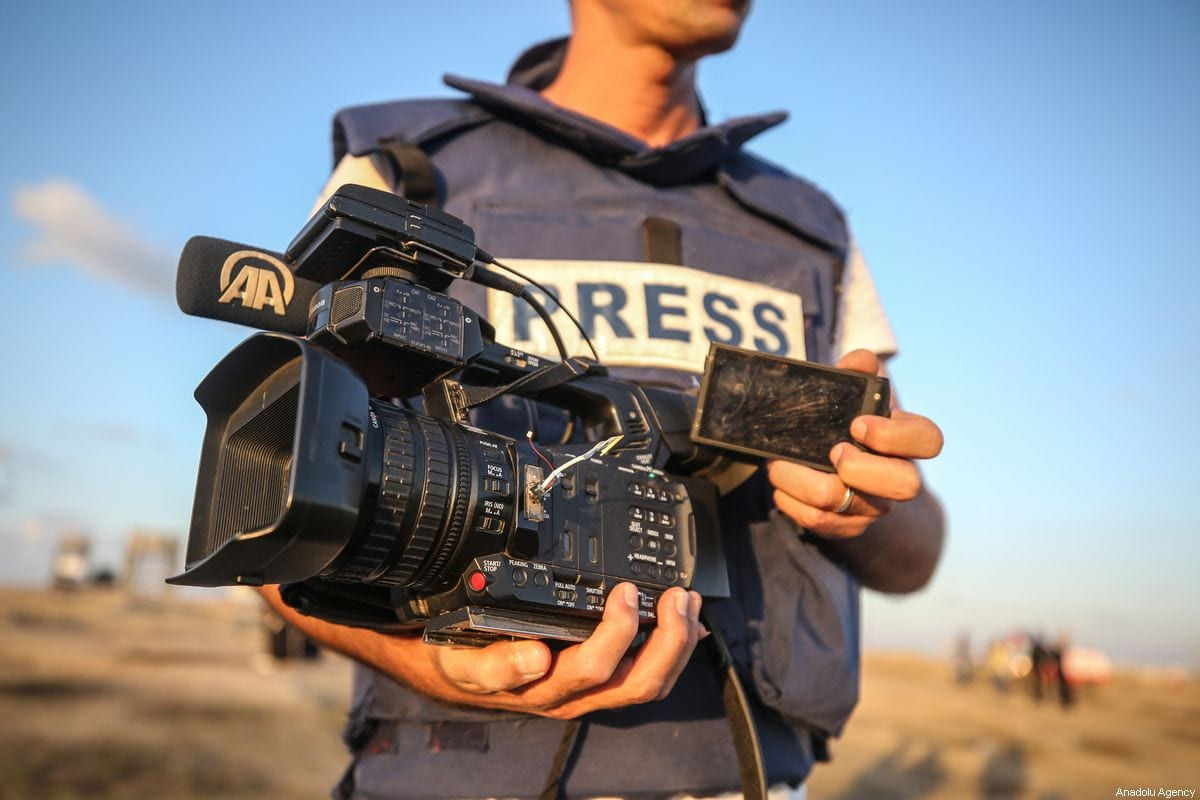 Anadolu Agency's photojournalist Muhammed Dahlan holds his damaged camera after it was shot with a rubber bullet by Israeli soldiers during protests near Gaza-Israel border in Gaza City, Gaza on October 18, 2019 [Ali Jadallah - Anadolu Agency]