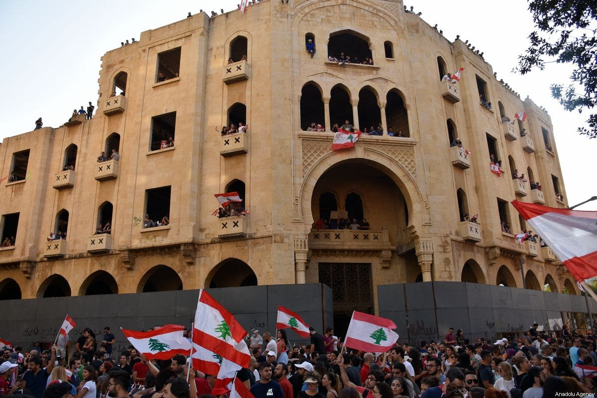 Lebanese demonstrators gather at Martyrs' Square and Riad Al Solh Square during an anti-government protest against dire economic conditions and new tax regulations on messaging services like Whatsapp, in Beirut, Lebanon on 19 October 2019. [Mahmut Geldi - Anadolu Agency]