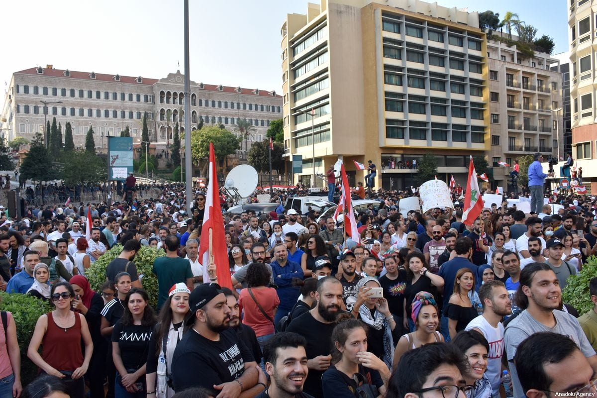 Lebanese demonstrators gather at Martyrs' Square and Riad Al Solh Square during an anti-government protest against dire economic conditions and new tax regulations on messaging services like Whatsapp, in Beirut, Lebanon on October 19, 2019 [Mahmut Geldi / Anadolu Agency]