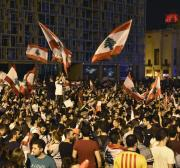 Facing protests, Lebanon approves emergency economic reforms