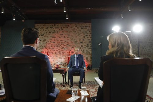 Turkish President Recep Tayyip Erdogan (C) answers the questions during the joint live broadcast by Turkish Radio and Television Corporation (TRT) in Istanbul, Turkey on 24 October 2019. [Mustafa Kamacı - Anadolu Agency]