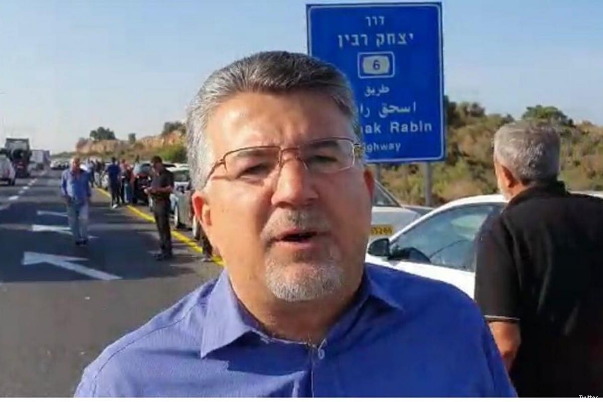 Knesset Member Dr Yousef Jabareen can be seen with the Palestinian citizens of Israel protesting calling for greater police presence in Arab communities to tackle violent crime on 10 October 2019