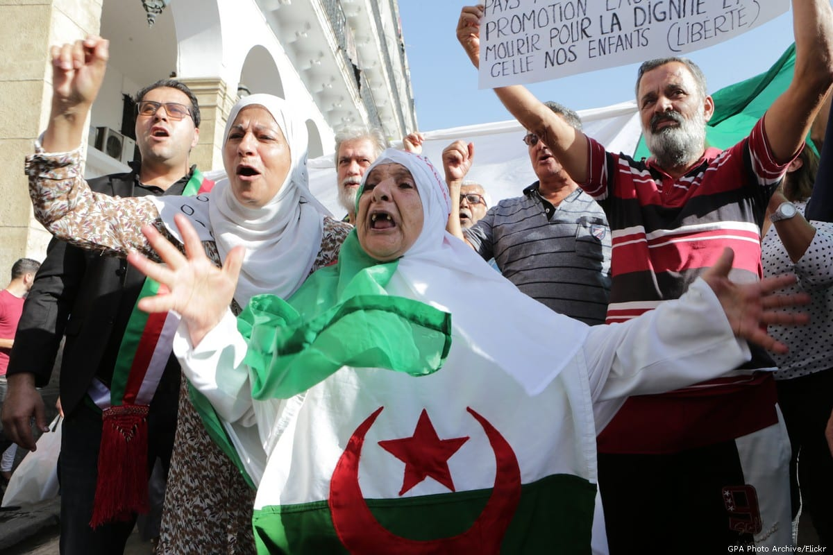 Algerians stage a protest in front of the parliamentary building in Algiers, Algeria on 13 October 2019 [Farouk Batiche/Anadolu Agency]
