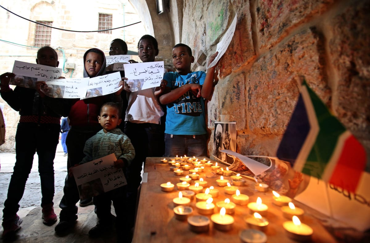 Palestinians gather at a candle memorial for late South African President Nelson Mandela in an area of Jerusalem's Old City popular to Africans, on 07 December 2013. [Saeed Qaq-Apaimages]