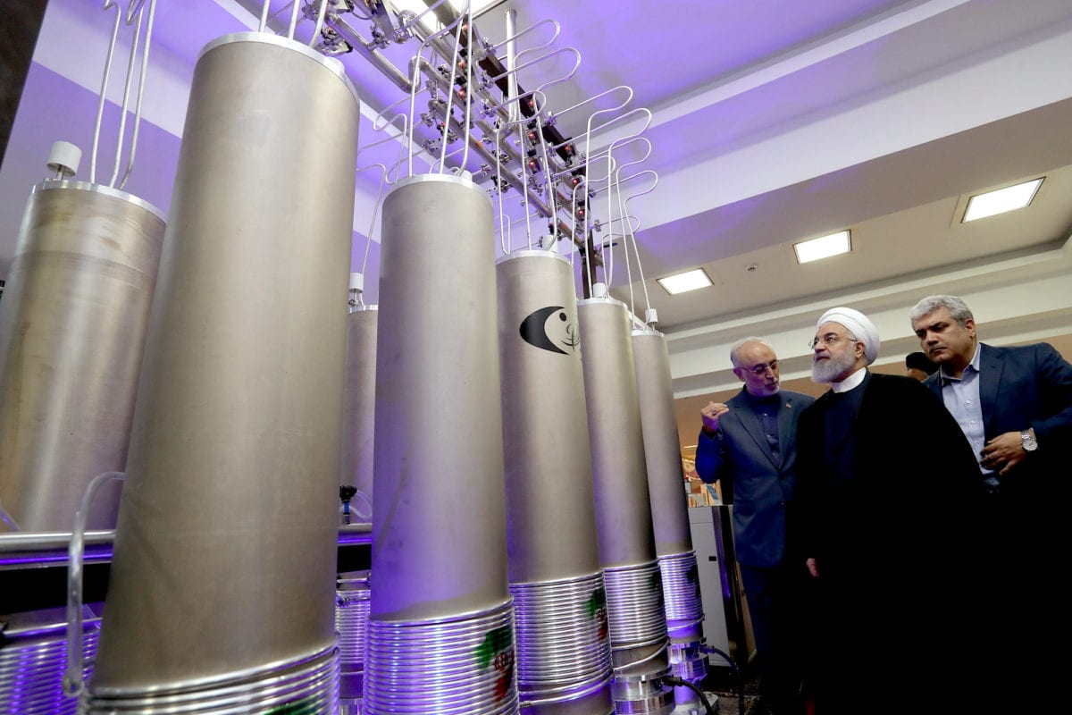Iranian President Hassan Rouhani seen at an exhibition of Iranian nuclear technologies, standing next to model centrifuges used to refine uranium and other nuclear materials, on April 9, 2019 [president.ir]