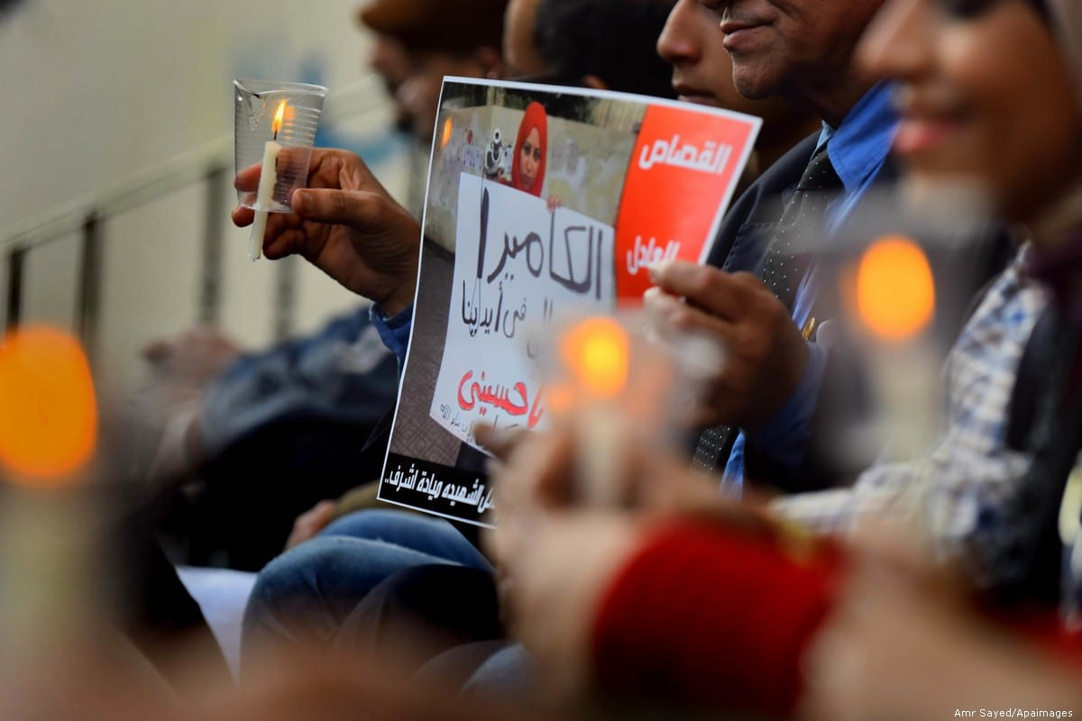 Egyptian journalists light candles during a protest the death of the Egyptian journalist Mayada Ashraf, in Cairo, on 28 March 2016 [Amr Sayed/Apaimages]