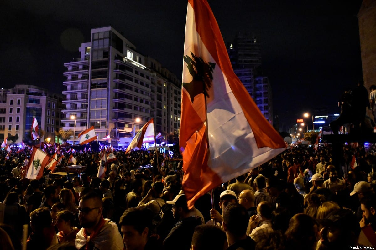 Demonstrators gather to stage a protest against the government's tax policy in Beirut, Lebanon on 23 October, 2019 [Mahmut Geldi/Anadolu Agency]