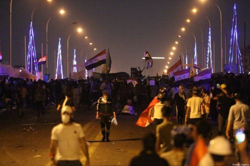 Iraqi protesters try to remove the security forces' barricades on Al-Sarafiya Bridge and try to enter the road of the high-security Green Zone, where key government offices and foreign embassies are based, during ongoing anti-government demonstrations at Tahrir Square in Iraq's capital Baghdad on 30 October 2019. [Murtadha Sudani - Anadolu Agency]