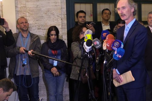 UN special envoy for Syria Geir Pedersen (R) speaks to media as the first session of Syrian Constitutional Committee ends in Geneva, Switzerland on 1 November, 2019 [Bayram Altuğ/Anadolu Agency]