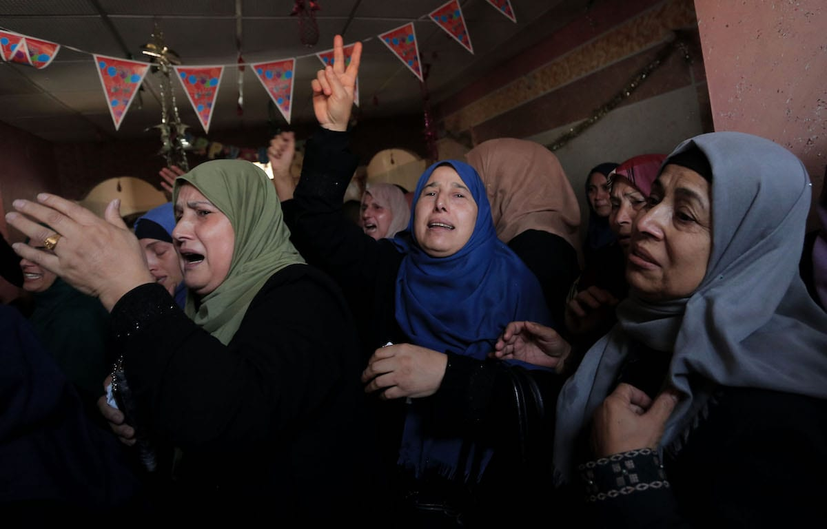 Relatives of Abdel Selam Ahmed and Abdullah Ellibesi, who were killed in Israeli airstrike, mourn during their funeral ceremony in Beit Hanoun, Gaza City, Gaza on 13 November 2019. [Ashraf Amra - Anadolu Agency]
