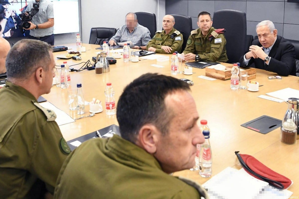 Israeli Prime Minister Benjamin Netanyahu (2nd R) and Israeli Defence Minister Naftali Bennett (R) hold a security meeting with high-level military officials at Southern Command in Beersheba, Israel on 13 November 2019. [Amos Ben Gershom / GPO / Handout - Anadolu Agency]