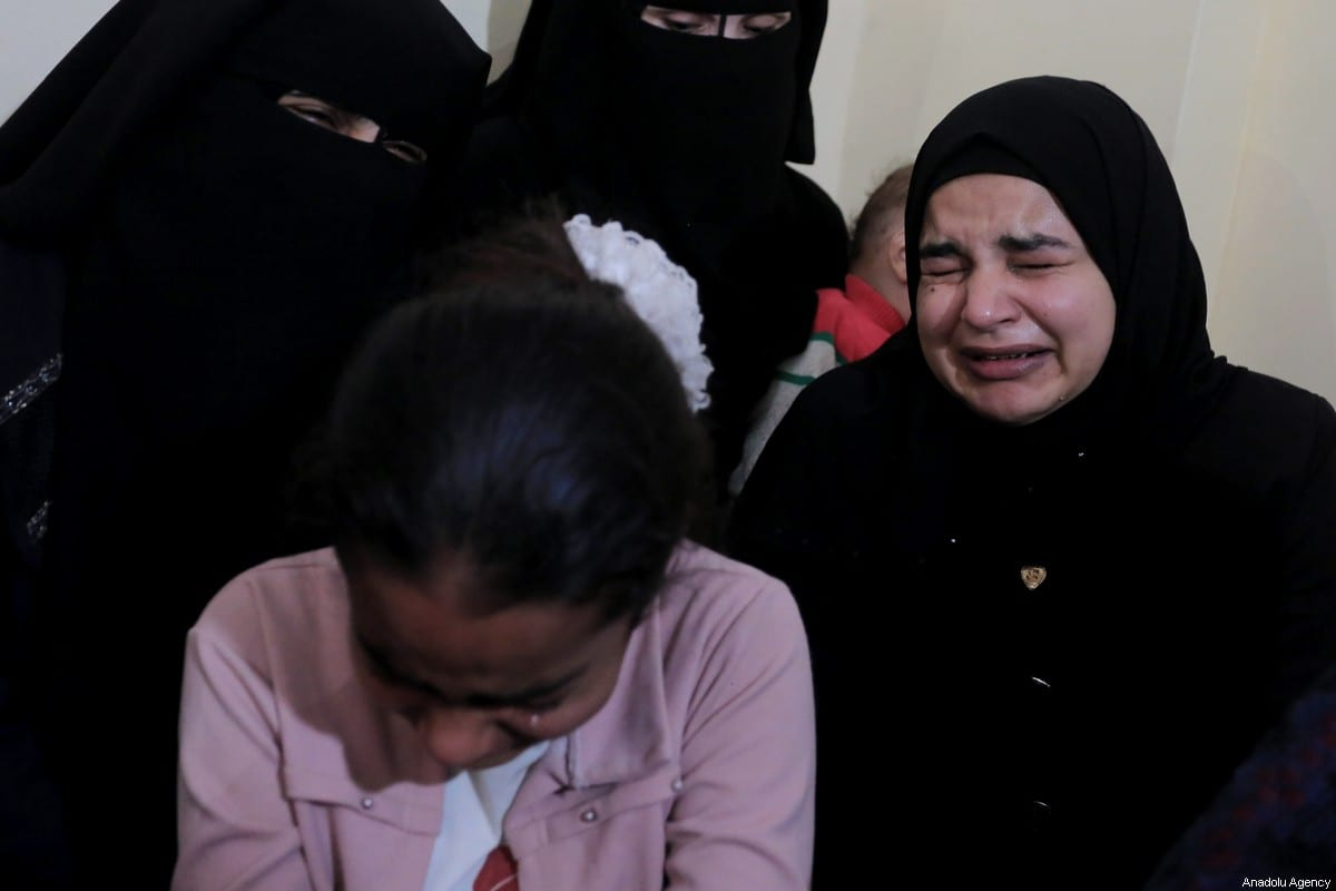 Relatives of Mohammad Sharab, a Palestinian man killed by Israeli airstrikes over Gaza, mourn during his funeral ceremony in Khan Yunis, Gaza on November 14, 2019 [Ashraf Amra / Anadolu Agency]