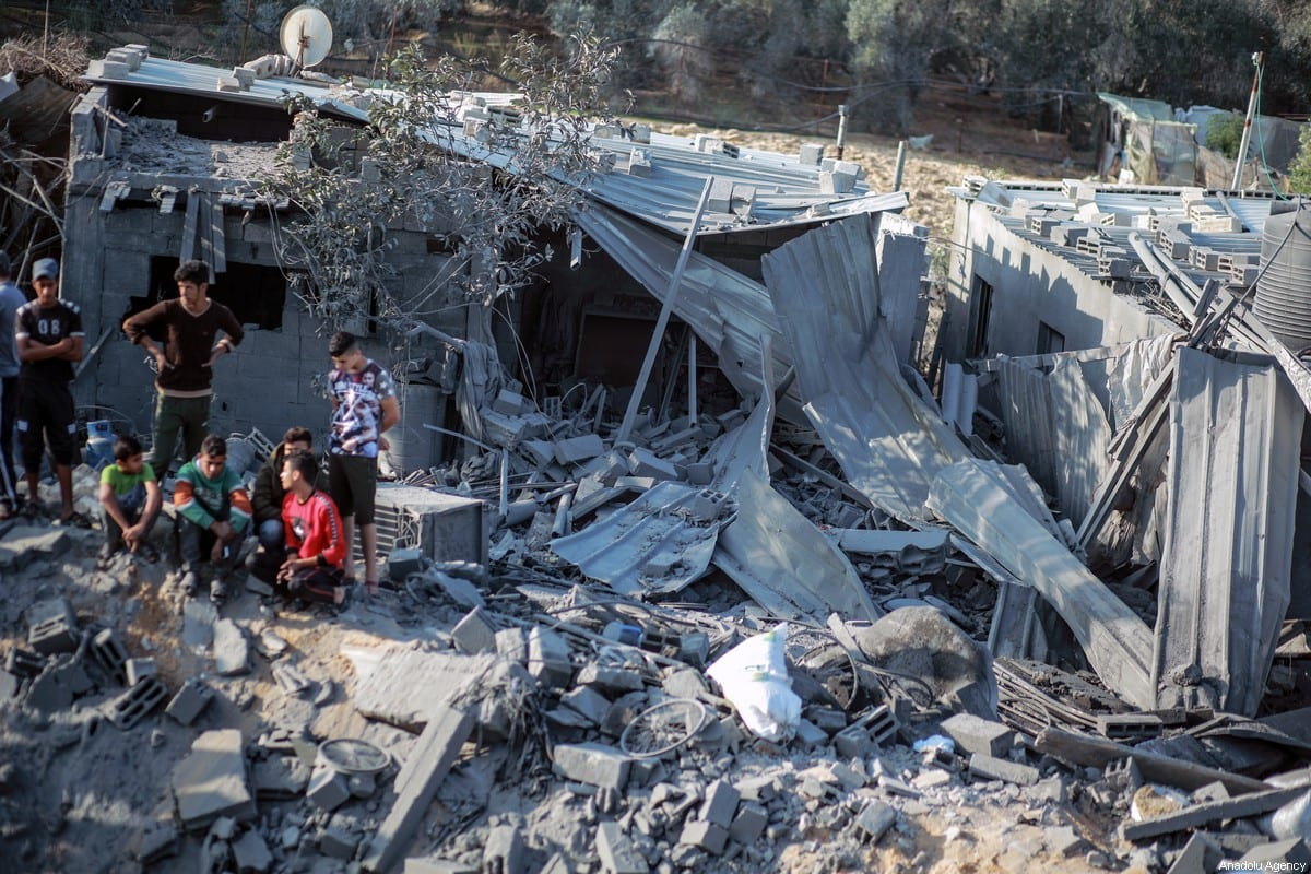 Gazans inspect the debris of a building after Israeli air strikes hit Gaza on 14 November 2019 [Ali Jadallah/Anadolu Agency]